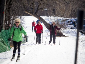 Cross-country skiers made their way down the groomed multi-use winter trail along the Sir John A. Macdonald Parkway near the Island Park Bridge Saturday March 18, 2017.