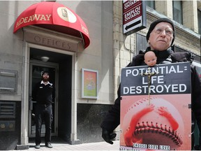 A protester stands outside the Morgentaler Clinic in Ottawa.