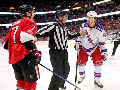 A linesman holds apart Kyle Turris and Brendan Smith in the third period.