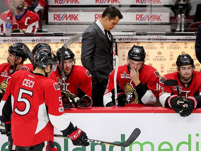 Coach Guy Boucher waits for a decision during a timeout in the first overtime period.