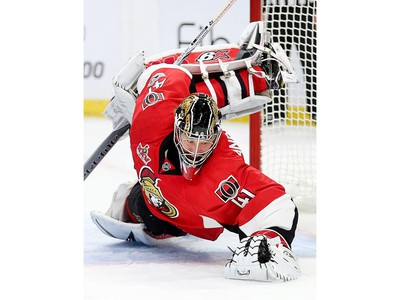 Craig Anderson jumps on the loose puck in the second period.