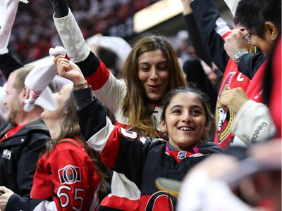 Fans celebrate the goal of Mark Stone.