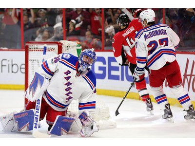 Goalie Henrik Lundqvist looks dejected while Jean-Gabriel Pageau celebrates his goal in the first period.