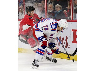 Kyle Turris and Brady Skjei battle for the puck in the first period.