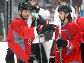 Marc Methot (L) and Erik Karlsson are good friends; After his trade to Dallas, Methot found it tough playing against his former teammates.