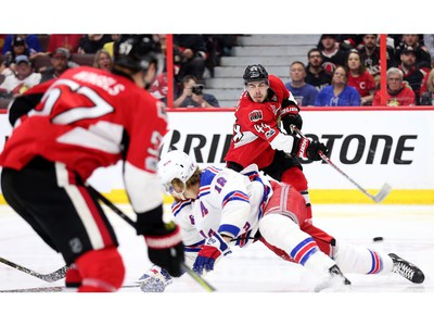Marc Staal tries to block Jean-Gabriel Pageau's shot but it would go in for the game-winning goal in the second overtime period.