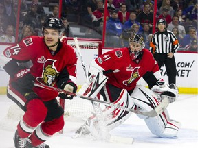 Senators defenceman Mark Borowiecki and goalie Craig Anderson keep an eye on the puck during Saturday's game against the Rangers.