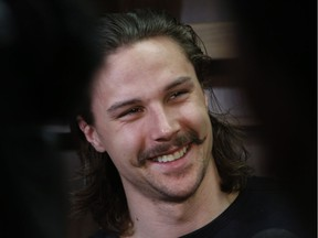 Ottawa Senators defenceman Erik Karlsson talks with reporters in the Senators' dressing room in Ottawa on Saturday, May 27, 2017. He said the moustache is likely going to go.