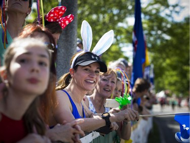 Fans, including Kathleen Ferland in the bunny ears, lined Queen Elizabeth Drive to cheer on runners during the 5k race.