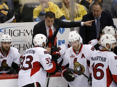 Ottawa Senators head coach Guy Boucher directs his team during overtime of Game 7 of the Eastern Conference final against the Pittsburgh Penguins in the NHL Stanley Cup hockey playoffs in Pittsburgh, Thursday, May 25, 2017.