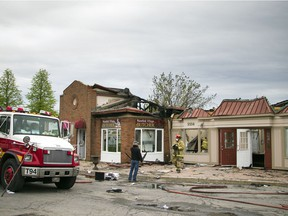 Ottawa Fire investigators were on the scene of an overnight commercial fire at 5556 Manotick Main Street Sunday May 21, 2017.