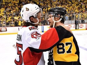 Erik Karlsson #65 of the Ottawa Senators congratulates Sidney Crosby #87 of the Pittsburgh Penguins after winning Game Seven of the Eastern Conference Final during the 2017 NHL Stanley Cup Playoffs at PPG PAINTS Arena on May 25, 2017 in Pittsburgh, Pennsylvania.