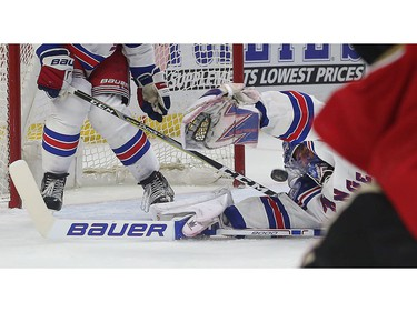 New York Rangers goalie Henrik Lundqvist stretches out in attempt to make the save.