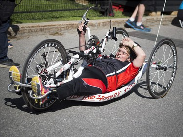 Ruth Hurst crossed the finish line on her hand cycle during the 5k race.