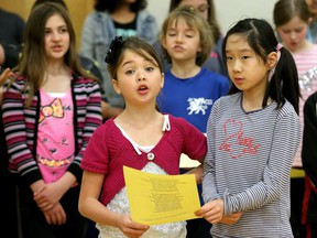 - Singers Avery Glaude and Chloe Wei, both in grade four,  sing their parts. Mentors from Listen Up - a program started by the Gryphon Trio to engage kids in music and the spoken word - were working with students at Adrienne Clarkson Elementary School Monday (May 15, 2017) in preparation for their big concert on Wednesday.