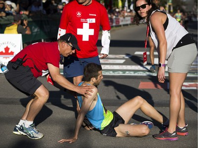 The medical team assists Adam Hortian at the finish line of the 10K race.