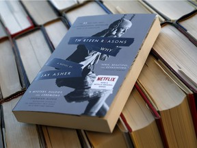 """This photo shows the book """"Thirteen Reasons Why"""" in a photo illustration Monday, May 15, 2017, in Phoenix. The popular Netflix series, based on the book, has sparked an important discussion about teen suicide, writes Louise Bradley."""