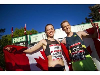 Top Canadian finishers Rachel Cliff and Eric Gillis at the finish line of the 10K race.