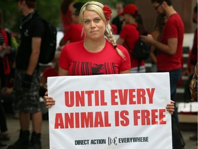 Jevranne Martel of the Ottawa Animal Defense League stands with her poster prior to the animal rights march on Saturday, June 17, 2017.