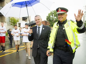 Matt Skof, president of the Ottawa Police Association, and Ottawa police Chief Charles Bordeleau make their way along the parade route during Capital Pride's 2016 parade.