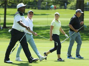 (L-R) Former NFL star Bo Jackson, John Veihmeyer, Chairman of KPMG International, Brooke Henderson of Canada and former MLB pitcher Greg Maddux stroll up a fairway during the pro-am  prior to the start of the 2017 KPMG Women's PGA Championship at Olympia Fields Country Club on June 27, 2017 in Olympia Fields, Illinois.