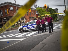 SIU investigators, on scene in downtown Ottawa earlier this month. The agency's updating requires political muscle, writes Tyler Dawson.
