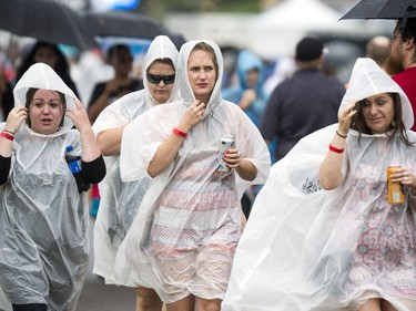 Ponchos were a popular sight for a while as the rain came down on the grounds at RBC Bluesfest Sunday July 9, 2017.