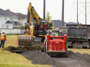 Construction is underway to expand the cycling network in Ottawa's east end, including these two paths site near Lavoie St. and Carmella Cres. in Orleans Friday, August 4, 2017.