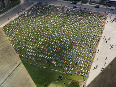 Hundreds of people take part in the last yoga on Parliament Hill event hosted by Lululemon Athletica Wednesday, August 30, 2017.