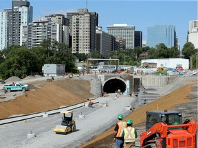 Construction workers in front of the tunnel where the new LRT will come through at the Pimisi Station on July 27, 2017.