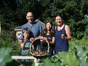L to R: Conrad Melanson, Luca Gervais, Marianne Gervais and Anne-Marie Gervais have turned their typical backyard into an incredible vegetable garden
