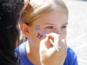 Mackenzie, 7, has her face painted at the Teal Tailgate Party before the Ovarian Cancer Walk of Hope in Ottawa on Saturday, September 2, 2017.