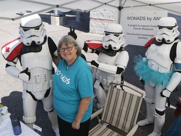 Ann Welbourn of Loretta Studios and Gallery poses with Star Wars characters at the Teal Tailgate Party before the Ovarian Cancer Walk of Hope.