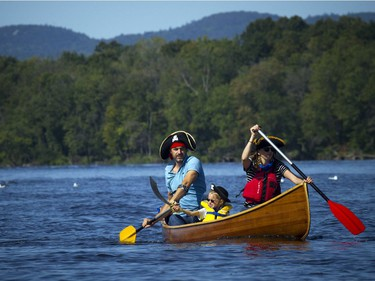 The Ottawa Riverkeeper held Ride the River family parade and picnic Sunday September 10, 2017. Various boats and boards were paddled down a stretch of the Ottawa River to celebrate the body of water that is the newest Canadian Heritage River. From left, Nicolas Moyer, five-year-old Saya Moyer and Sophie Cathelineau were dressed like pirates as they celebrate Nicolas's birthday by paddling down the river.