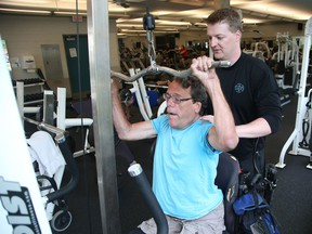 Ryan Armitage with John Woodhouse, who has dystonia and is a double leg amputee at the JCC in Ottawa, July 31, 2017.