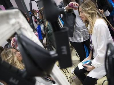 Melisa Caron gets her hair curled at the National Women's Show that took place Saturday, Oct. 21, 2017 at the EY Centre.