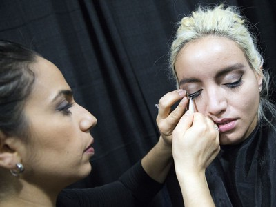 Amanda Guillen does Shelby Del Franko's lashes before a fashion show during the National Women's Show that took place Saturday, Oct. 21, 2017 at the EY Centre.