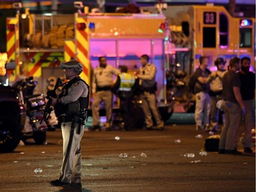 A Las Vegas Metropolitan Police Department officer stands in the intersection of Las Vegas Boulevard and Tropicana Ave. after a mass shooting at a country music festival nearby on October 2, 2017 in Las Vegas, Nevada. A gunman has opened fire on a music festival in Las Vegas, leaving at least 20 people dead and more than 100 injured. Police have confirmed that one suspect has been shot. The investigation is ongoing.
