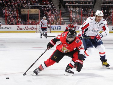 Senators defenceman Johnny Oduya knocks the puck away from a streaking Alex Ovechkin in the first period at the Canadian Tire Centre on Thursday, Oct. 5, 2017.