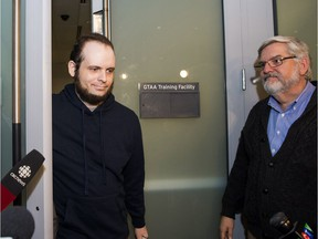 This file photo shows Joshua Boyle and his father at the airport in Toronto on Friday, October 13, 2017.