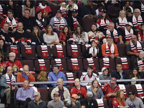 Scarves mark empty seats in the crowd as the Ottawa Senators take on the Washington Capitals in their season opener at the Canadian Tire Centre on Thursday, October 5, 2017. The building was slightly less than full for Game 1.