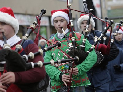 TThe annual Help Santa Toy Parade made its way through downtown Ottawa, featuring familiar festive floats, marching bands, city councillors, firefighters and more, with volunteers collecting toys for less fortunate children along the way, on Saturday, Nov. 18, 2017