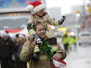 The annual Help Santa Toy Parade made its way through downtown Ottawa, featuring familiar festive floats, marching bands, city councillors, firefighters and more, with volunteers collecting toys for less fortunate children along the way, on Saturday, Nov. 18, 2017
