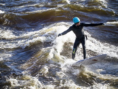 David Alicandro didn't let a little cold weather stop him from getting out for a surf Saturday December 16, 2017 on the Ottawa River.