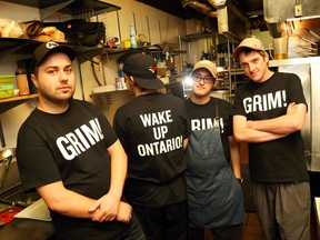 Nolan Tanner, Mike Madigan, Adam Ghor and Nick Thompson, cooks at the Black Tomato, will lose their jobs when the restaurant closes at the end of the month. Owner Peter Besserer has made up 'Wake Up Ontario' tshirts for his staff to wear.