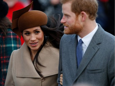(L-R) US actress and finacee of Britain's Prince Harry Meghan Markle and Britain's Prince Harry arrive to attend the Royal Family's traditional Christmas Day church service at St Mary Magdalene Church in Sandringham, Norfolk, eastern England, on December 25, 2017.