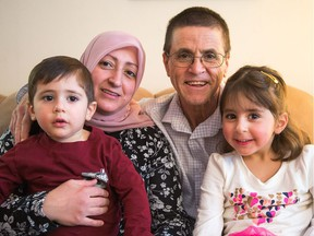 Ottawa academic Hassan Diab in his Ottawa home with his family, his wife Rania Tfaily, daughter Jena, 5, and son Jad, 3.