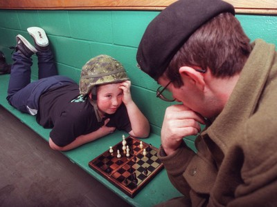 Ottawa 1998 Ice Storm - Nick Scott (11 years of at the time) plays chess with Trooper Greg Nowak from Toronto's Queens York Rangers at the Highlands Community Center in Lanark.