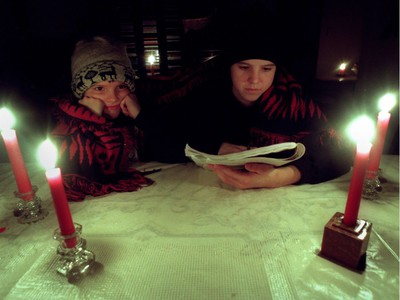 Ottawa 1998 Ice Storm - Allison Eagon, then 13, does her homework by candlelight in her family's Glebe Ave. home as sister Charlotte, 7, looks on Jan. 6, 1998.
