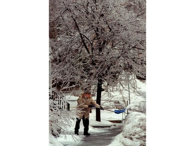 Ottawa 1998 Ice Storm - A man shovels the ice from his walkway.
